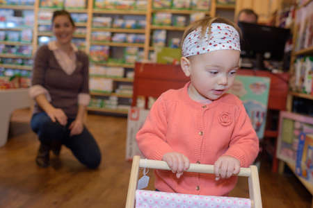 blind girl: young mother her daughter shopping at the toy store Stock Photo