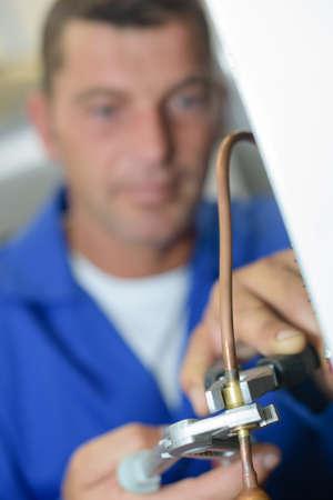worker cutting wire