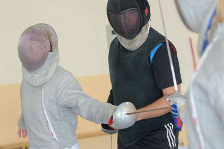 People practicing fencing Stock Photo