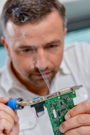 Soldering a video card Stock Photo