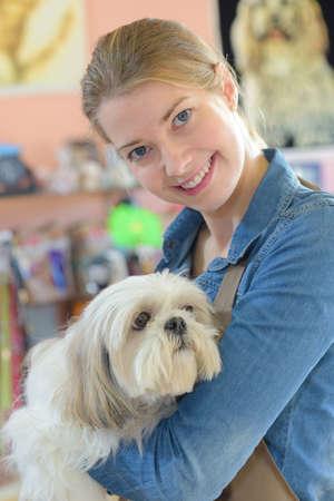 breed: Animal worker holding dog