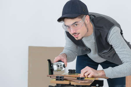 watertight: steamfitter posing with a tube Stock Photo