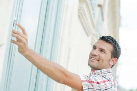 Man ringing at a door Stock Photo