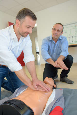 reanimate: Man learning cpr Stock Photo