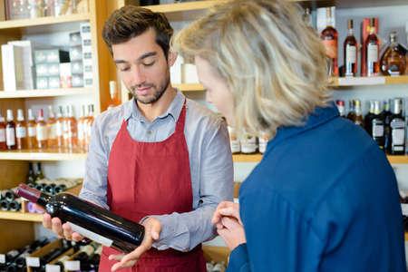 merchant: Wine merchant recommending bottle to customer