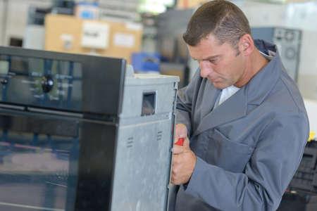 oven technician doing his work