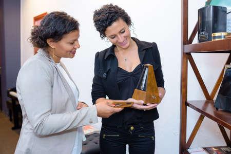 metronome: Women looking at metronome