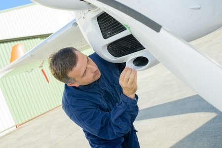 Mechanic inspecting aircraft