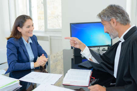 judge talking with client