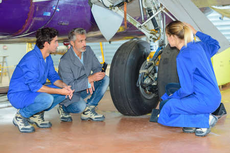 technical department: team under the aircraft Stock Photo