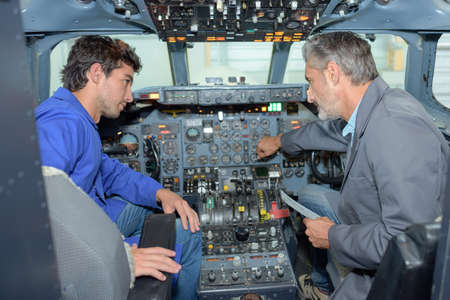 Man and student in cockpit of aircraft Stock Photo