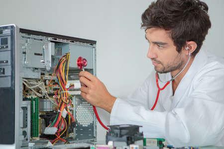 man fixing a CPU Stock Photo