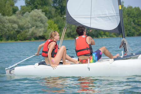 couple having a sailing lesson on a lake Stock Photo