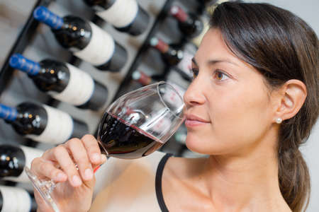 Woman smelling wine Stock Photo