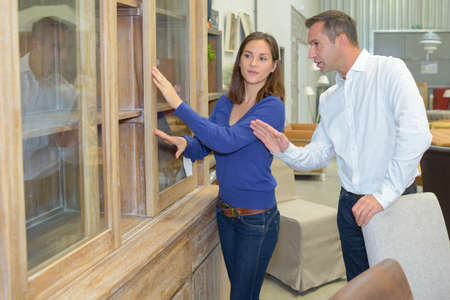 furnishings: Couple looking at furniture in a shop Stock Photo