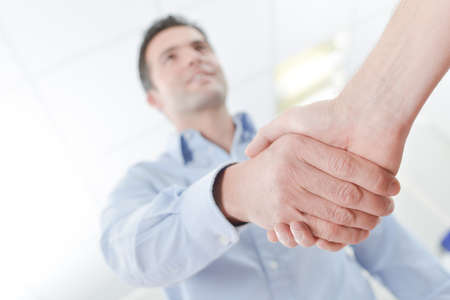 acknowledge: man shaking hand