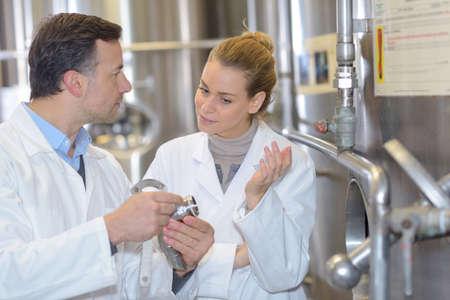 Technicians discussing industrial part
