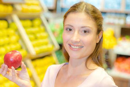brunett: woman holding an apple