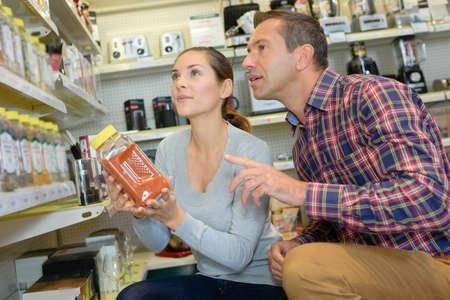 ingredient: Man and woman ingredient shopping