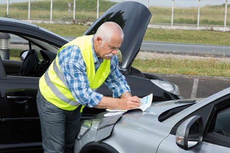 trafic: senior establishing friendly report after trafic accident Stock Photo
