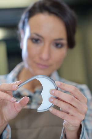 observable: woman looking at a broken piece Stock Photo
