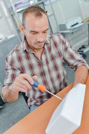 splice: Handyman fixing an electrical appliance
