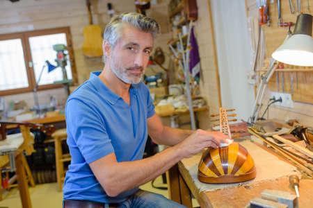 sculpt: instrument maker in workshop