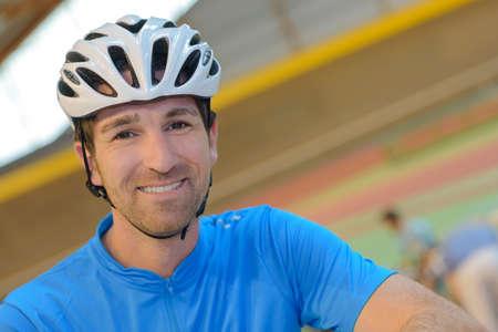 Portrait of man wearing cycling helmet Stock Photo