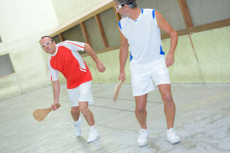 Men playing racket sport Stock Photo