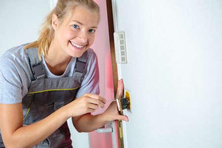 woman locksmith on call Stock Photo