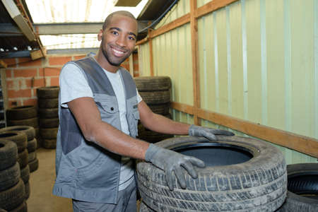 remount: worker and tires Stock Photo