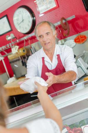 serf: butcher serving customer