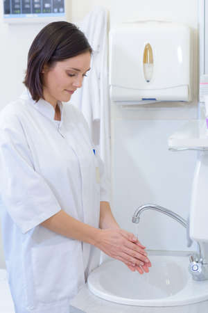 a lady doctor: nurse washing hands Stock Photo