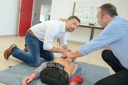 traineeship: rescuer teaching a man how to proceed during a traineeship Stock Photo