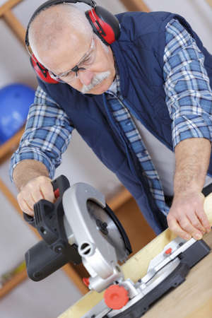craft material: carpenter with power grinder Stock Photo