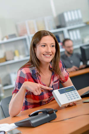 corroboration: Lady at desk pointing to display on calculator