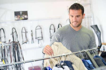shopper: shopper in specialised goods store Stock Photo