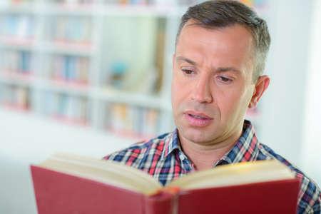 phrase novel: man reading a book