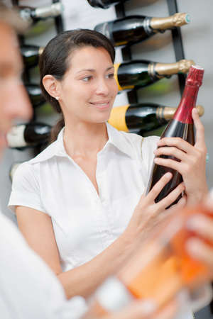 Woman holding a bottle of alcohol Stock Photo
