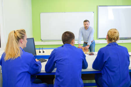 vocational high school: professor with students