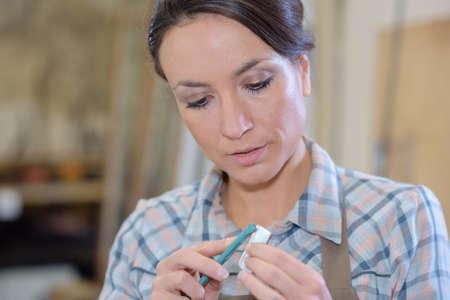 sculp: woman artisan at work