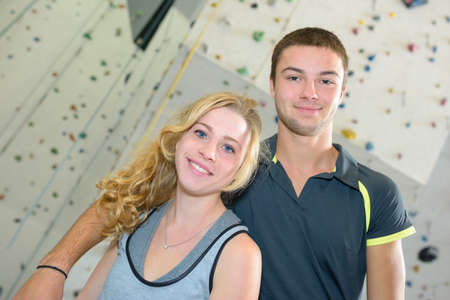 Young couple at indoor climbing center