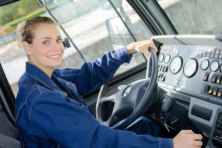 Portrait of woman in cab of vehicle Stock Photo