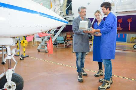 component: avionics technician at work