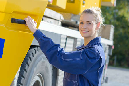 Woman holding drivers door of plant vehicle Stock Photo