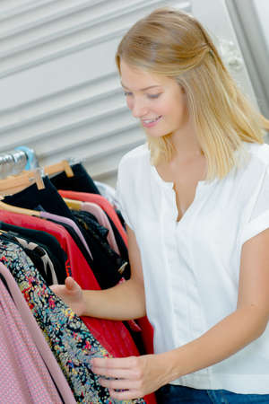 blind date: woman choosing clothes Stock Photo