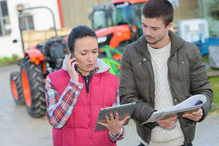 coutryside: agronomist helping farmer planning the harvest