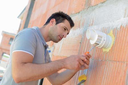 suspend: Repairing air vent Stock Photo
