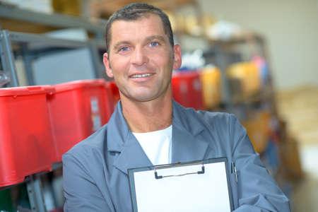 Portrait of man holding blank clipboard