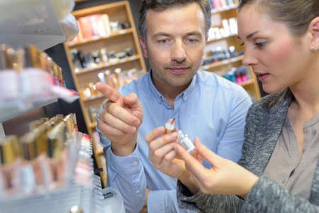 anniversary sexy: saleswoman and man shopping for girlfriend Stock Photo